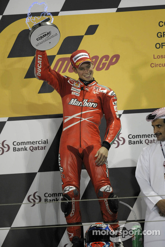 Podium: race winner Casey Stoner celebrates