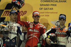 Podium: Sieger Casey Stoner mit Jorge Lorenzo und Dani Pedrosa