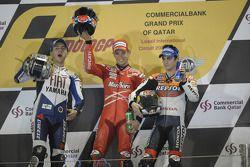 Podium: race winner Casey Stoner with Jorge Lorenzo and Dani Pedrosa