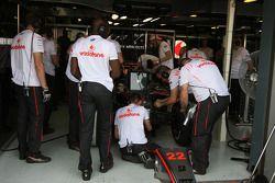 McLaren team members work on the MP4-23