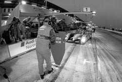 Audi Sport North America team member waits for Tom Kristensen