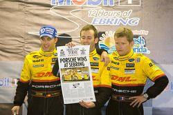 Podium: race winners Timo Bernhard, Romain Dumas and Emmanuel Collard celebrate