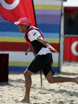 Lewis Hamilton running up the beach to take victory, McLaren Mercedes