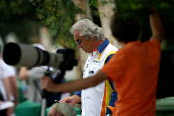 Flavio Briatore, Renault F1 Team, Team Chief, Managing Director as Laurent Charniaux, F1 Photographer looks on