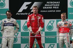 Podium : le vainqueur Kimi Raikkonen, le second Robert Kubica, le troisième Heikki Kovalainen