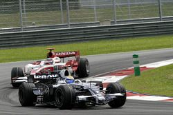 Nico Rosberg, WilliamsF1 Team, FW30 and Takuma Sato, Super Aguri F1, SA08
