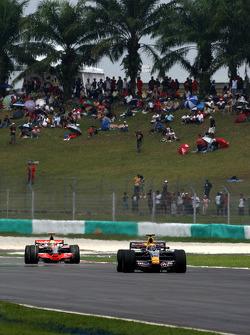 Mark Webber, Red Bull Racing leads Lewis Hamilton, McLaren Mercedes