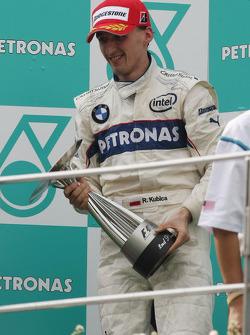 Podio: ganador de la carrera Kimi Raikkonen, segundo lugar de Robert Kubica