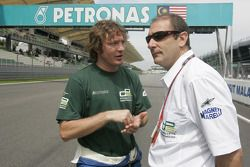Bruno Michel talks to Marco Codelloon the grid before the start of the race