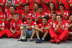 Team celebration: race winner Kimi Raikkonen celebrates with Felipe Massa and Scuderia Ferrari team