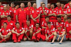 Team celebration: race winner Kimi Raikkonen celebrates with Felipe Massa and Scuderia Ferrari team