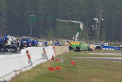 Tony Bartone's Funny car body being lifted over saftey wall after hitting both walls during qualifing round 1.