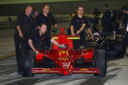 Newman Haas Lanigan Racing team members push the car on pitlane