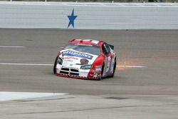 Kasey Kahne slides his damaged car to the pit lane