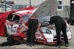 Work on Kasey Kahne's damaged car