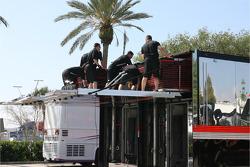 IndyCar crew members unload gear