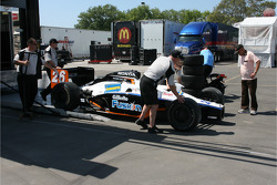 Car of Marco Andretti is unloaded