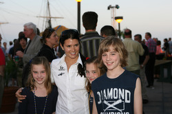 Danica Patrick poses with fans during the Honda welcome party