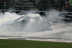 Kyle Busch's car is engulfed in smoke during his burn out
