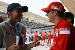 Себастьян Феттель, Scuderia Toro Rosso, и Кими Райкконен, Scuderia Ferrari
