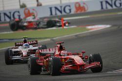 Kimi Raikkonen, Scuderia Ferrari, F2008 leads Anthony Davidson, Super Aguri F1 Team, SA08