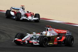 Adrian Sutil, Force India F1 Team, Jarno Trulli, Toyota Racing