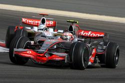 Heikki Kovalainen, McLaren Mercedes,Adrian Sutil, Force India F1 Team