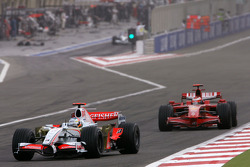 Adrian Sutil, Force India F1 Team, Kimi Raikkonen, Scuderia Ferrari