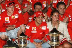 Race winner Felipe Massa celebrates with his wife Rafaela, teammate Kimi Raikkonen, Stefano Domenic
