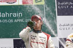 Kamui Kobayashi celebrates his victory on the podium