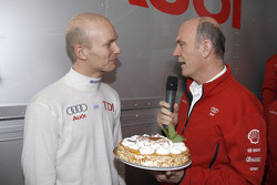Dr Wolfgang Ullrich has a birthday present for Alexandre Prémat