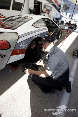 Mike Edwards crewmembers share a laugh, while preparing new GM GXP Pro Stock for Friday competition