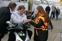 Norbert Haug, Sporting Director Mercedes-Benz, signing an autograph