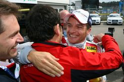 Hans-Jurgen Abt, Teamchef Abt-Audi, congratulates Timo Scheider, Audi Sport Team Abt Sportsline, wit