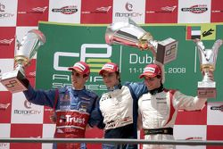 Marco Bonanomi celebrates victory on the podium with Sebastien Buemi and Jerome D'Ambrosio