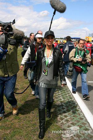 Cora Schumacher, wife of Ralf Schumacher, on the grid, working for DTM TV
