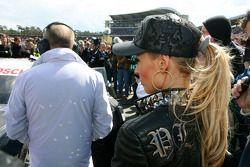 Cora Schumacher, wife of Ralf Schumacher, on the grid wit her husbands car