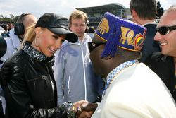 Cora Schumacher, wife of Ralf Schumacher, on the grid chatting with the King of Benin