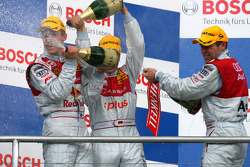 Podium: champagne for Mattias Ekström, Timo Scheider and Tom Kristensen