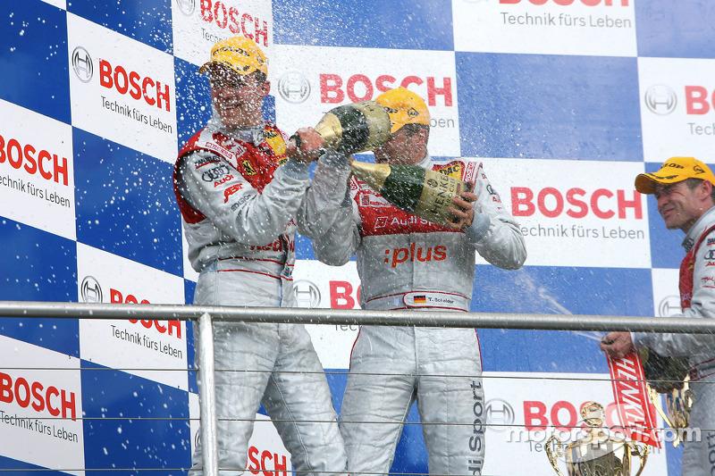 Podium: champagne for Mattias Ekström, Timo Scheider and Tom Kristensen