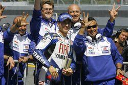 Pole winner winner Jorge Lorenzo celebrates with his team