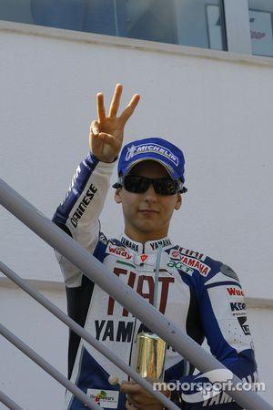 Pole winner winner Jorge Lorenzo celebrates