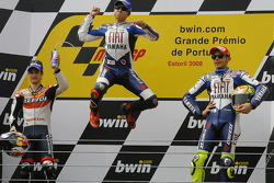 Podium: race winner Jorge Lorenzo celebrates with Dani Pedrosa and Valentino Rossi