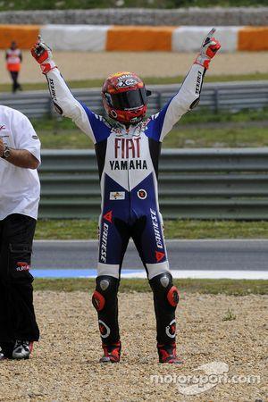 Race winner Jorge Lorenzo celebrates