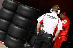 Bridgestone technician and slick tyres