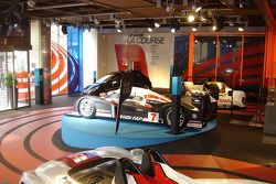 Peugeot 908 HDi FAP and race cars on display at Peugeot Avenue Paris