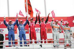 GT500 podium: class and overall winners Satoshi Motoyama and Benoit Treluyer, second place Tsugio Matsuda and Sébastien Philippe, third place Ralph Firman and Takuya Izawa
