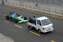 The car of Ryan Hunter-Reay is taken to pitlane