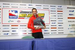 Helio Castroneves with the pole winner award