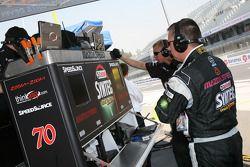 SpeedSource crew members watch qualifying